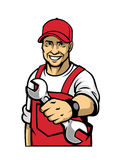 Mechanic hold a wrench Royalty Free Stock Photography