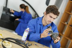 Mechanic holding automobile component royalty free stock images