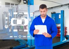 Mechanic holding a clipboard against a digital interface Stock Image