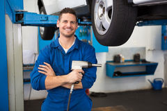 Mechanic holding a drill tool Royalty Free Stock Photo