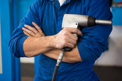 Mechanic holding a drill tool Stock Images