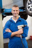 Mechanic holding a drill tool Stock Image