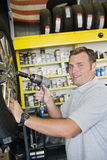 Mechanic Holding Electronic Screw Fitter Stock Photo