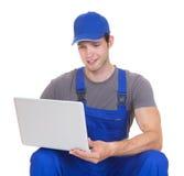 Mechanic holding laptop Royalty Free Stock Image