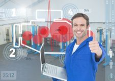 Mechanic holding a laptop and showing thumbs up. Digital composition of mechanic holding a laptop and showing thumbs up Stock Image