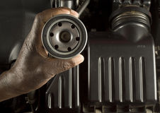 Mechanic holding oil filter Stock Photos