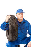 Mechanic is holding one car tire Stock Photo