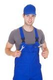 Mechanic holding ratchet Stock Photo
