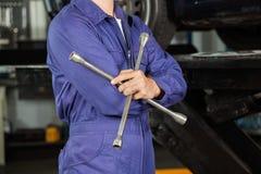 Mechanic Holding Rim Wrench Stock Image