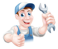 Mechanic holding spanner Royalty Free Stock Image