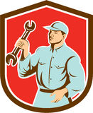 Mechanic Holding Spanner Wrench Shield Retro Stock Photography