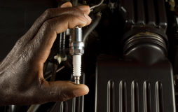 Mechanic holding spark plug Royalty Free Stock Images