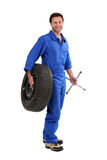 Mechanic holding a tire Stock Image