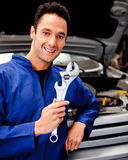 Mechanic holding a tool Stock Photography