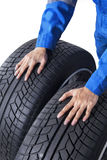 Mechanic holding two tires Stock Image