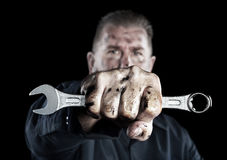Mechanic Holding Wrench Royalty Free Stock Photography