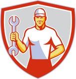 Mechanic Holding Wrench Crest Retro Stock Photography