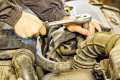 The mechanic of the hood of a car repair Royalty Free Stock Photo