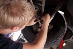 Mechanic Inspecting CV Joint stock images