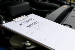 Mechanic Inspecting damage car Stock Photography