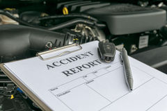 Mechanic Inspecting damage car Stock Images