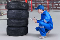 Mechanic inspecting the tires texture Royalty Free Stock Photography