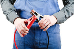 Mechanic and jumper cables Stock Image