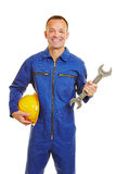 Mechanic in jumpsuit with helmet and jaw wrench Stock Images