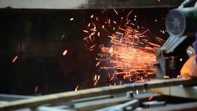 Mechanic labour man cuts heavy iron steel polishes metal grinder welding sparking industry worker