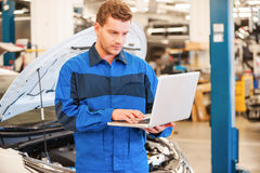 Mechanic with laptop. Stock Image