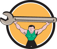 Mechanic Lifting Giant Spanner Wrench Circle Cartoon Royalty Free Stock Image