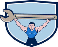 Mechanic Lifting Giant Spanner Wrench Crest Cartoon Royalty Free Stock Images