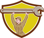 Mechanic Lifting Spanner Wrench Crest Cartoon Royalty Free Stock Photography