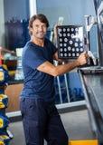 Mechanic Looking Away While Adjusting Wheel Aligner Royalty Free Stock Image