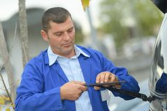 Mechanic looking into car issue stock photo