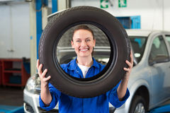 Mechanic looking through tire wheel Royalty Free Stock Photo