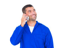 Mechanic looking up while talking on mobile phone Stock Image