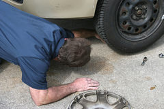 Mechanic Looks Under Car Royalty Free Stock Photo