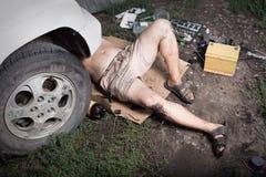 Mechanic lying and working Stock Photos