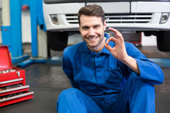 Mechanic lying and working under car Royalty Free Stock Image