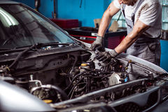 Mechanic maintaining car engine Stock Photos