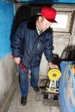 Mechanic makes repair of elevators Stock Images