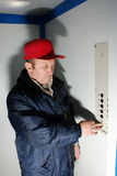 Mechanic makes repair of elevators Royalty Free Stock Images