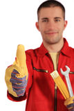 Mechanic making positive gesture. All on white background Royalty Free Stock Photography