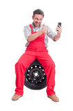 Mechanic making a video call showing like Royalty Free Stock Image