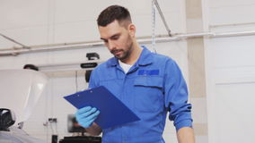 Mechanic man with clipboard at car workshop 17 stock footage