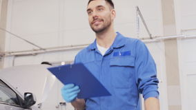 Mechanic man with clipboard at car workshop 16 stock footage