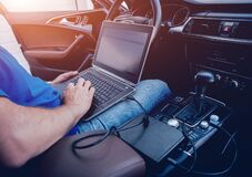 Free Mechanic Man With Laptop Making Car Diagnostics At Auto Service Royalty Free Stock Image - 172280266