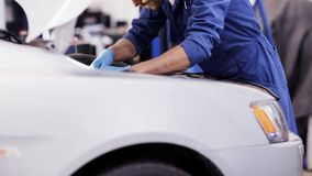 Mechanic man with wrench repairing car at workshop 54 stock footage