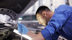 Mechanic man with wrench repairing car at workshop 45 stock footage
